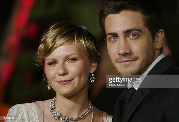 Actress Kirsten Dunst and Actor Jake Gyllenhaal attend The 2004 Vanity Fair Oscar Party at Mortons Restaurant February 29 2004 in Hollywood California