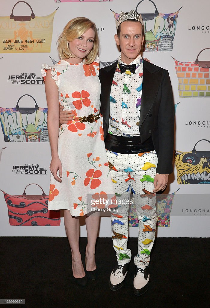 Actress Kirsten Dunst and designer Jeremy Scott attend the Jeremy Scott for Longchamp 10th Anniversary held at a Private Residence on November 5, 2015 in Beverly Hills, California.