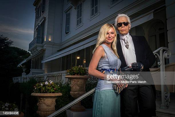 Actress Kirsten Dunst and Karl Lagerfeld, photographed at the amfAR Cinema Against AIDS gala, for Paris Match on May 24 in Cap d'Antibes, France.