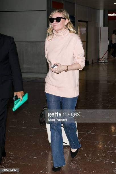 Actress Kirsten Dunst arrives at CharlesdeGaulle airport on July 1 2017 in Paris France