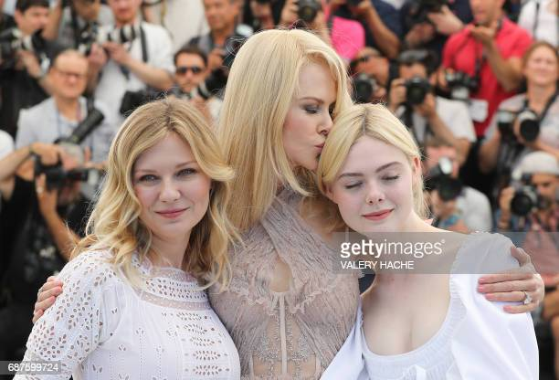 TOPSHOT US actress Kirsten Dunst Australian actress Nicole Kidman and US actress Elle Fanning pose on May 24 2017 during a photocall for the film...