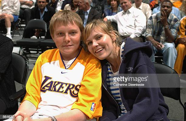 Actress Kirsten Dunst sits courtside with her brother Christian during Game five of the Western Conference Semifinals between the Los Angeles Lakers...