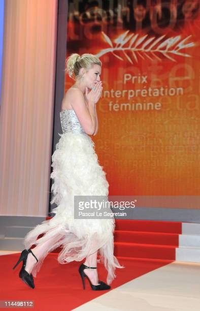 Actress Kirsten Dunst walks on stage to accept her award for Best Actress at the Closing Ceremony at the Palais des Festivals during the 64th Cannes...