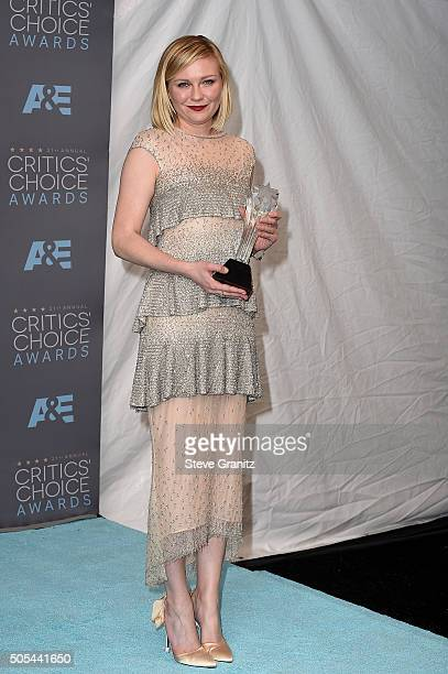 """Actress Kirsten Dunst, winner of the award for Best Actress in a Movie Made for Television or Limited Series for """"Fargo,"""" poses in the press room..."""