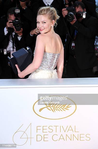 """Actress Kirsten Dunst with her Award for Best Actress in the film """"Melancholia"""" during the Palme D'Or Winners Photocall at the 64th Annual Cannes..."""