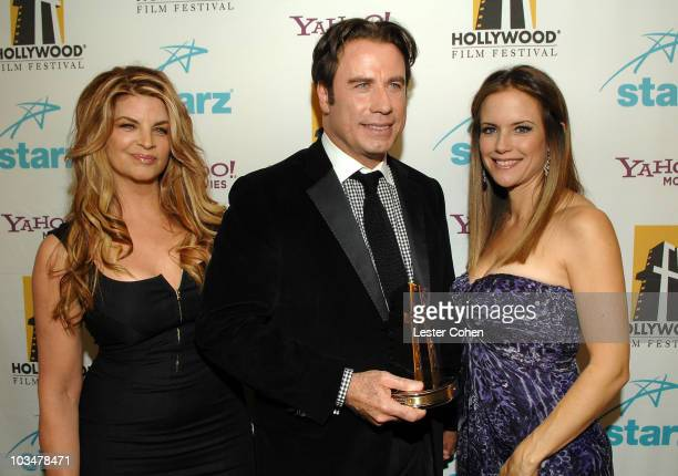 Actress Kirstie Alley actor John Travolta and actress Kelly Preston backstage at Hollywood Film Festival's Hollywood Awards at the Beverly Hilton...