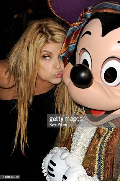 """Actress Kirstie Alley and Mickey Mouse arrive at premiere of Walt Disney Pictures' """"Pirates of the Caribbean: On Stranger Tides"""" held at Disneyland..."""