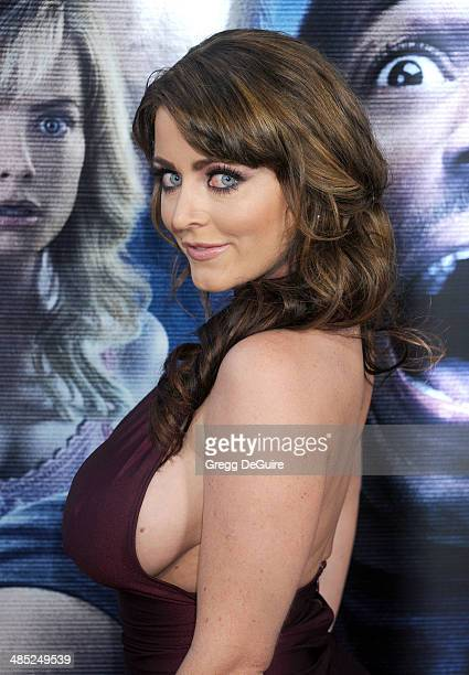 Actress Kirsty Hill arrives at the Los Angeles premiere of 'A Haunted House 2' at Regal Cinemas LA Live on April 16 2014 in Los Angeles California