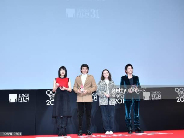 Actress Kiryu Mai actor Lien Binh Phat actress Karelle Tremblay and actor Nijiro Murakami attend the closing ceremony of the 31st Tokyo International...