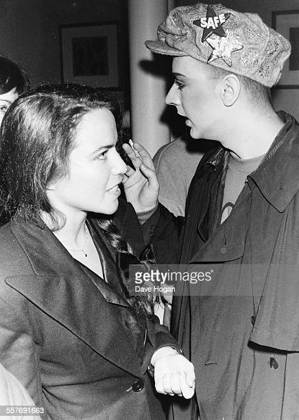 Actress Koo Stark and singer Boy George at the premiere after party for the film 'Personal Services' at Browns London April 3rd 1987