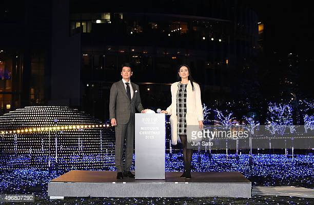 Actress Koyuki and actor Toshiaki Karasawa attend the lighting ceremony for the holiday season illumination on November 12 2015 in Tokyo Japan