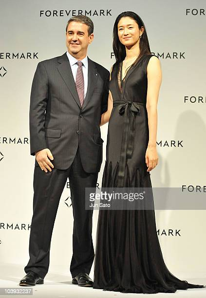 Actress Koyuki and David Rudlin Forevermark International Markets Director pose for a photograph during the Forevermark Award ceremony at the Park...