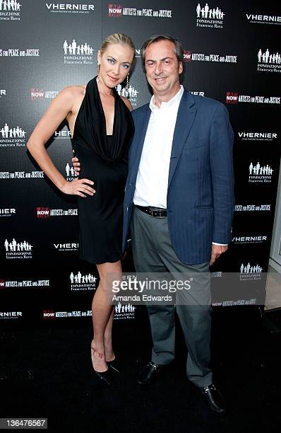 Actress Kristanna Loken and Vhernier Jewels President Carlo Traglio arrive at the Artists for Peace and Justice A Ring to Educate a Child in Haiti...