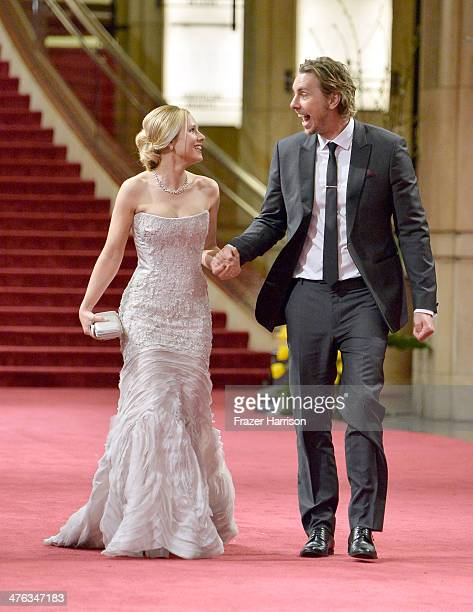 Actress Kristen Bell and Actor Dax Shepard depart the Oscars at Hollywood Highland Center on March 2 2014 in Hollywood California