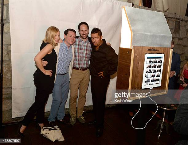 Actress Kristen Bell and actor Francis Capra pose with fans at the after party for the premiere of 'Veronica Mars' at Sadies Kitchen on March 12 2014...