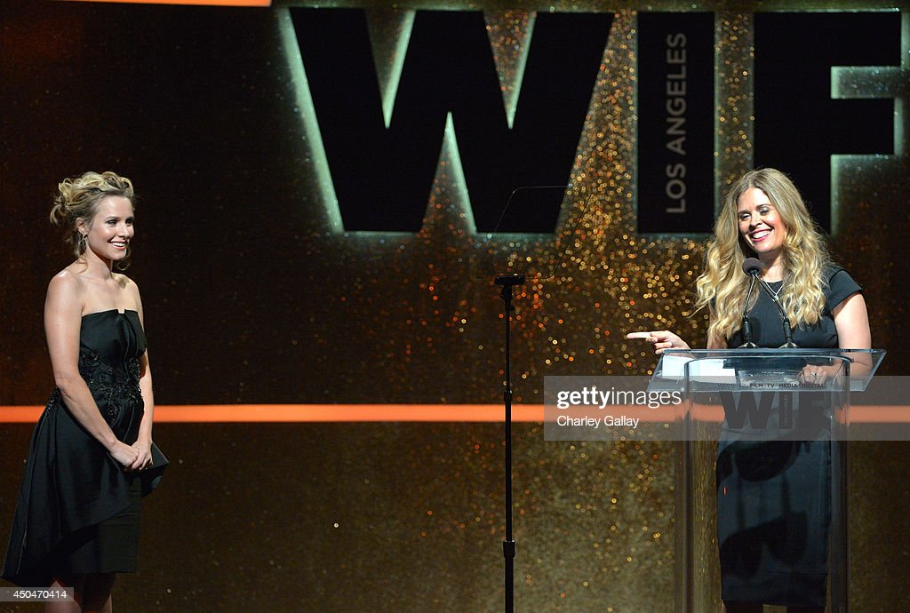 Actress Kristen Bell (L) looks on as director Jennifer Lee accepts the Dorothy Arzner Directors Award onstage at Women In Film 2014 Crystal + Lucy Awards presented by MaxMara, BMW, Perrier-Jouet and South Coast Plaza held at the Hyatt Regency Century Plaza on June 11, 2014 in Los Angeles, California.