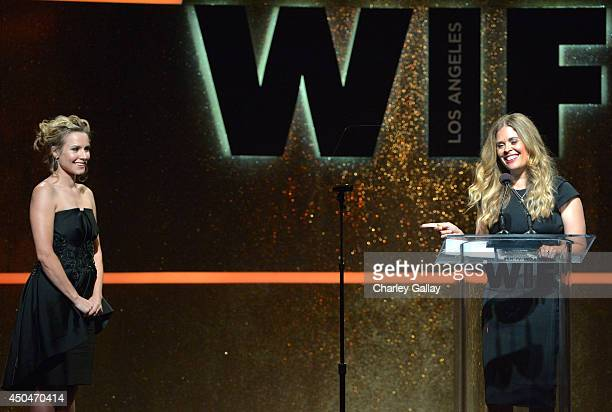 Actress Kristen Bell looks on as director Jennifer Lee accepts the Dorothy Arzner Directors Award onstage at Women In Film 2014 Crystal Lucy Awards...