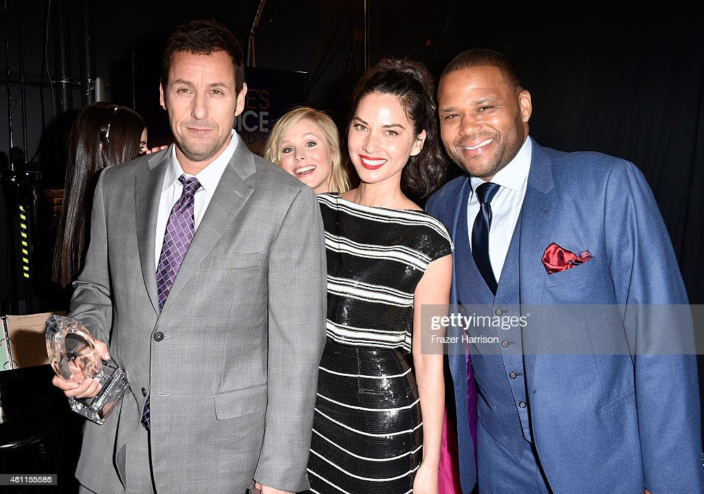 Actress Kristen Bell (2nd from L) photobombs (L-R) actor Adam Sandler, actress Olivia Munn and actor Anthony Anderson at the The 41st Annual People's Choice Awards at Nokia Theatre LA Live on January 7, 2015 in Los Angeles, California.