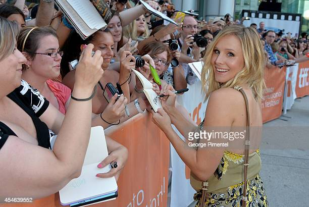 Actress Kristen Bell signs autographs as she attends The Judge premiere during the 2014 Toronto International Film Festival at Roy Thomson Hall on...