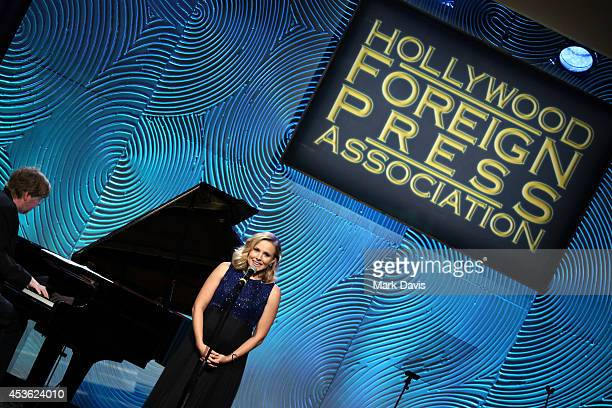 Actress Kristen Bell speaks onstage at the Hollywood Foreign Press Association's Grants Banquet at The Beverly Hilton Hotel on August 14 2014 in...