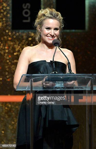 Actress Kristen Bell speaks onstage at Women In Film 2014 Crystal Lucy Awards presented by MaxMara BMW PerrierJouet and South Coast Plaza held at the...