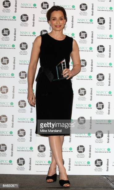 Actress Kristen Scott Thomas holds her Award for Best British Actress in a supporting role at The 29th Annual London Critics' Circle Film Awards at...