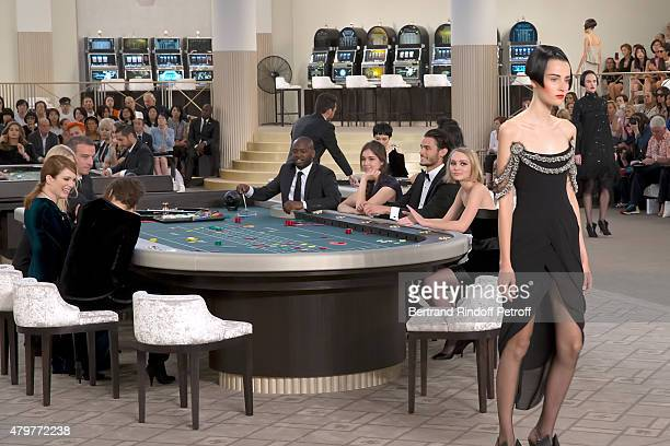 Actress Kristen Stewart Actress Julianne Moore Actress Tugba Sunguroglu Baptiste Giabiconi and LilyRose Depp attend the Chanel show as part of Paris...