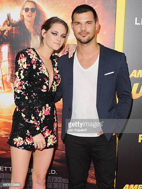 Actress Kristen Stewart and actor Taylor Lautner arrive at the Los Angeles Premiere 'American Ultra' at Ace Theater Downtown LA on August 18 2015 in...