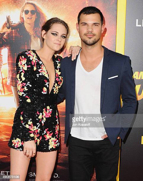 Actress Kristen Stewart and actor Taylor Lautner arrive at the Los Angeles Premiere American Ultra at Ace Theater Downtown LA on August 18 2015 in...