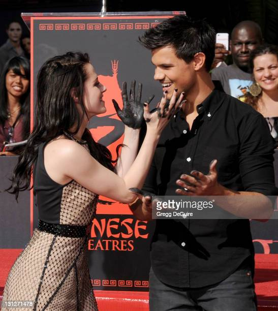 """Actress Kristen Stewart and actor Taylor Lautner at """"The Twilight Trio"""" Hand/Foorprint Ceremony at Grauman's Chinese Theatre on November 3, 2011 in..."""
