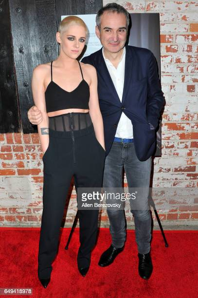 Actress Kristen Stewart and director Olivier Assayas attend the premiere of IFC Films' Personal Shopper at The Carondelet House on March 7 2017 in...