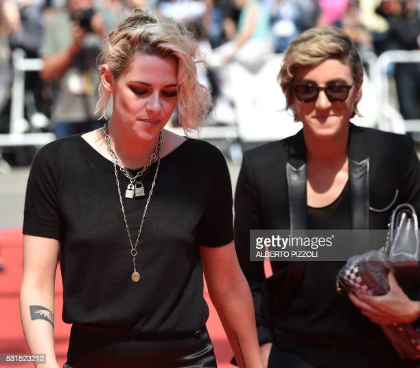 US actress Kristen Stewart and US visual effects producer Alicia Cargile arrive on May 15 2016 for the screening of the film 'American Honey' at the...