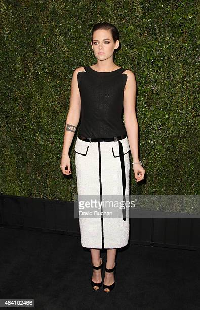 Actress Kristen Stewart attends the Chanel and Charles Finch Pre-Oscar Dinner at Madeo Restaurant on February 21, 2015 in Los Angeles, California.