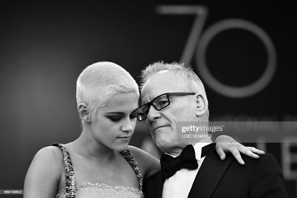 US actress Kristen Stewart (L) is greeted on May 20, 2017 by the General Delegate of the Cannes Film Festival Thierry Fremaux as she arrives for the screening of the film '120 Beats Per Minute (120 Battements Par Minute)' at the 70th edition of the Cannes Film Festival in Cannes, southern France. /