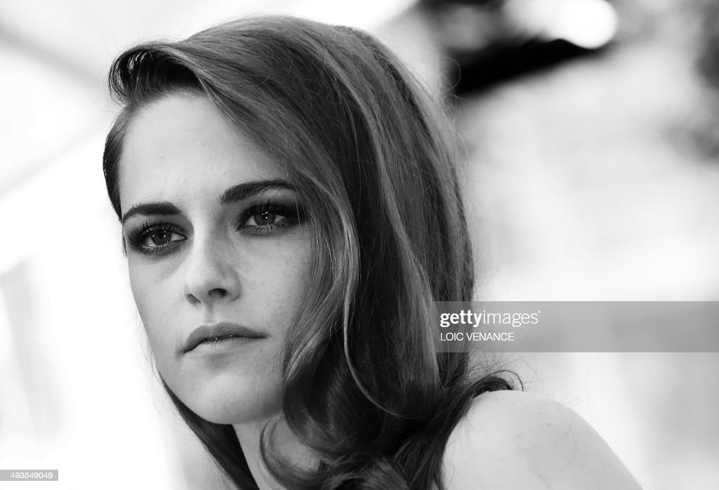 US actress Kristen Stewart poses as she arrives for the screening of the film 'Sils Maria' at the 67th edition of the Cannes Film Festival in Cannes, southern France, on May 23, 2014.