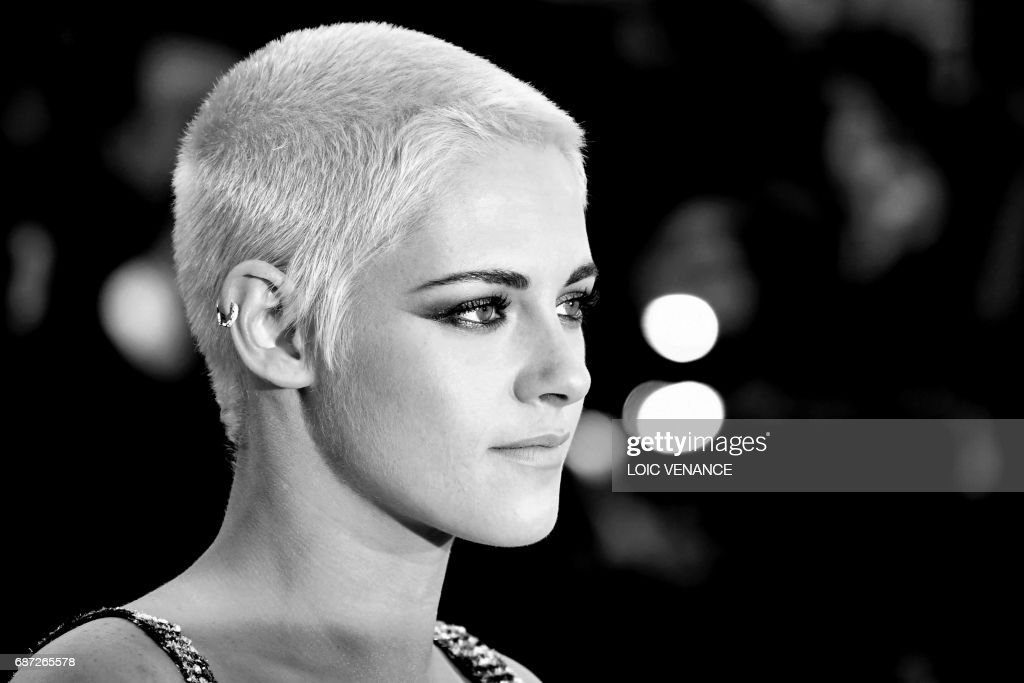 US actress Kristen Stewart poses as she arrives on May 20, 2017 for the screening of the film '120 Beats Per Minute (120 Battements Par Minute)' at the 70th edition of the Cannes Film Festival in Cannes, southern France. /