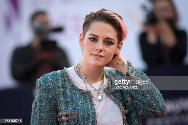 Actress Kristen Stewart poses as she arrives on the red carpet to attend the award ceremony of the 45th Deauville US Film Festival in Deauville,...