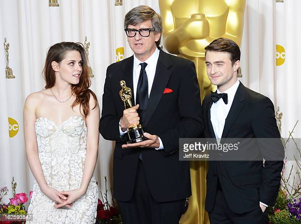 Actress Kristen Stewart production designer Rick Carter and actor Daniel Radcliffe pose in the press room during the Oscars at Loews Hollywood Hotel...