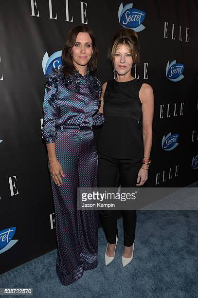 Actress Kristen Wiig and ELLE editorinchief Robbie Myers attend the Women In Comedy event with July cover stars Leslie Jones Melissa McCarthy Kate...