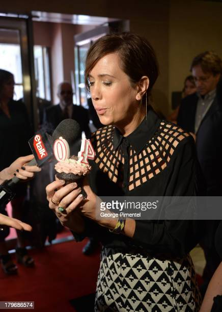 Actress Kristen Wiig celebrates her 40th Birthday with a cupcake as she arrives at 'Hateship Loveship' Premiere during the 2013 Toronto International...