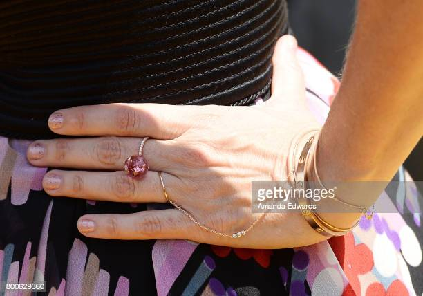 Actress Kristen Wiig jewelry detail arrives at the premiere of Universal Pictures and Illumination Entertainment's 'Despicable Me 3' at The Shrine...