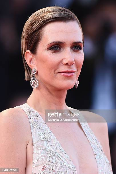 Actress Kristen Wiig walks the red carpet ahead of the 'Downsizing' screening and Opening Ceremony during the 74th Venice Film Festival at Sala...