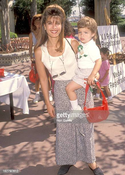 Actress Kristian Alfonso and son Gino Macauley attend the Happy Birthday Camp Snoop A Festive Celebration Marking the 10th Birthday of the Children's...