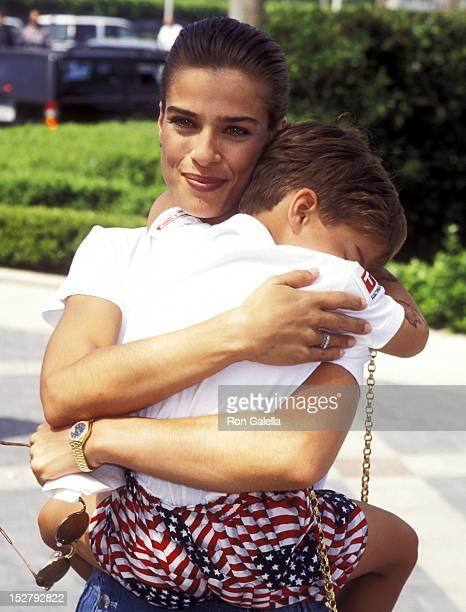 Actress Kristian Alfonso and son Gino Macauley attend The Indian in the Cupboard Hollywood Premiere on July 8 1995 at Paramount Studios in Hollywood...