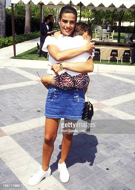 Actress Kristian Alfonso and son Gino Macauley attend 'The Indian in the Cupboard' Hollywood Premiere on July 8 1995 at Paramount Studios in...