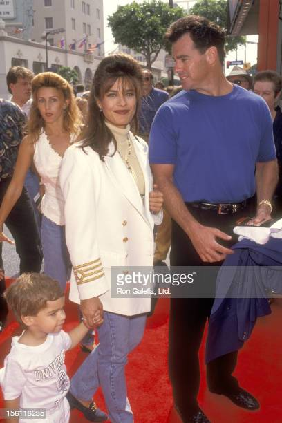 Actress Kristian Alfonso boyfriend Michael Palumbo and her son Gino Macauley attend the 'Dennis the Menace' Hollywood Premiere on June 19 1993 at...