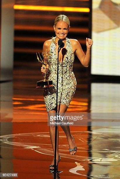 Actress Kristin Chenoweth accepts her award onstage at the 61st Primetime Emmy Awards held at the Nokia Theatre on September 20 2009 in Los Angeles...