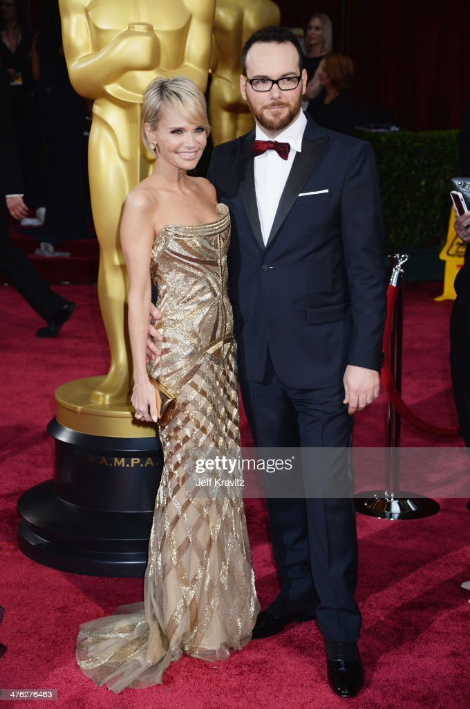 Actress Kristin Chenoweth (L) and Dana Brunetti attend the Oscars held at Hollywood & Highland Center on March 2, 2014 in Hollywood, California.