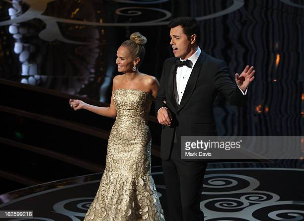 Actress Kristin Chenoweth and host Seth MacFarlane onstage during the Oscars held at the Dolby Theatre on February 24 2013 in Hollywood California