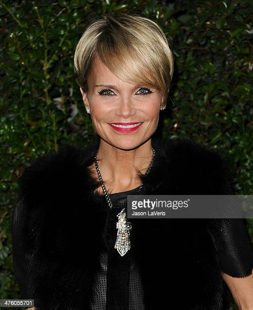 Actress Kristin Chenoweth attends the Chanel and Charles Finch preOscar dinner at Madeo Restaurant on March 1 2014 in Los Angeles California